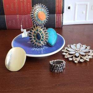 Rings. Ring holder, and Brooch.